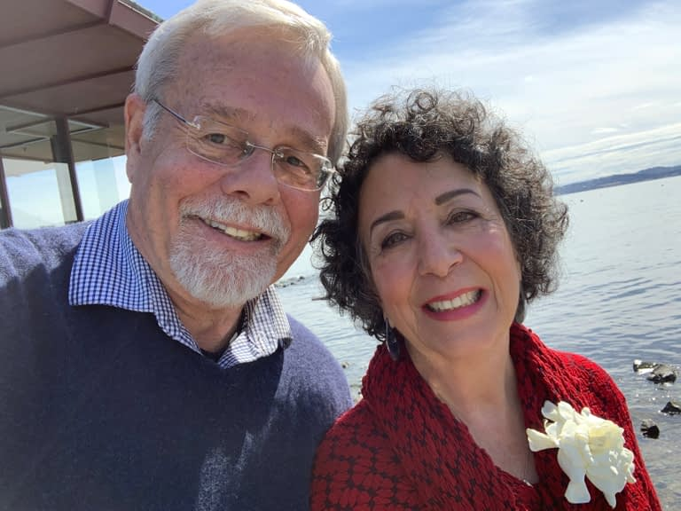 Toni Gattone smiles with her husband, Tim on the waterfront.