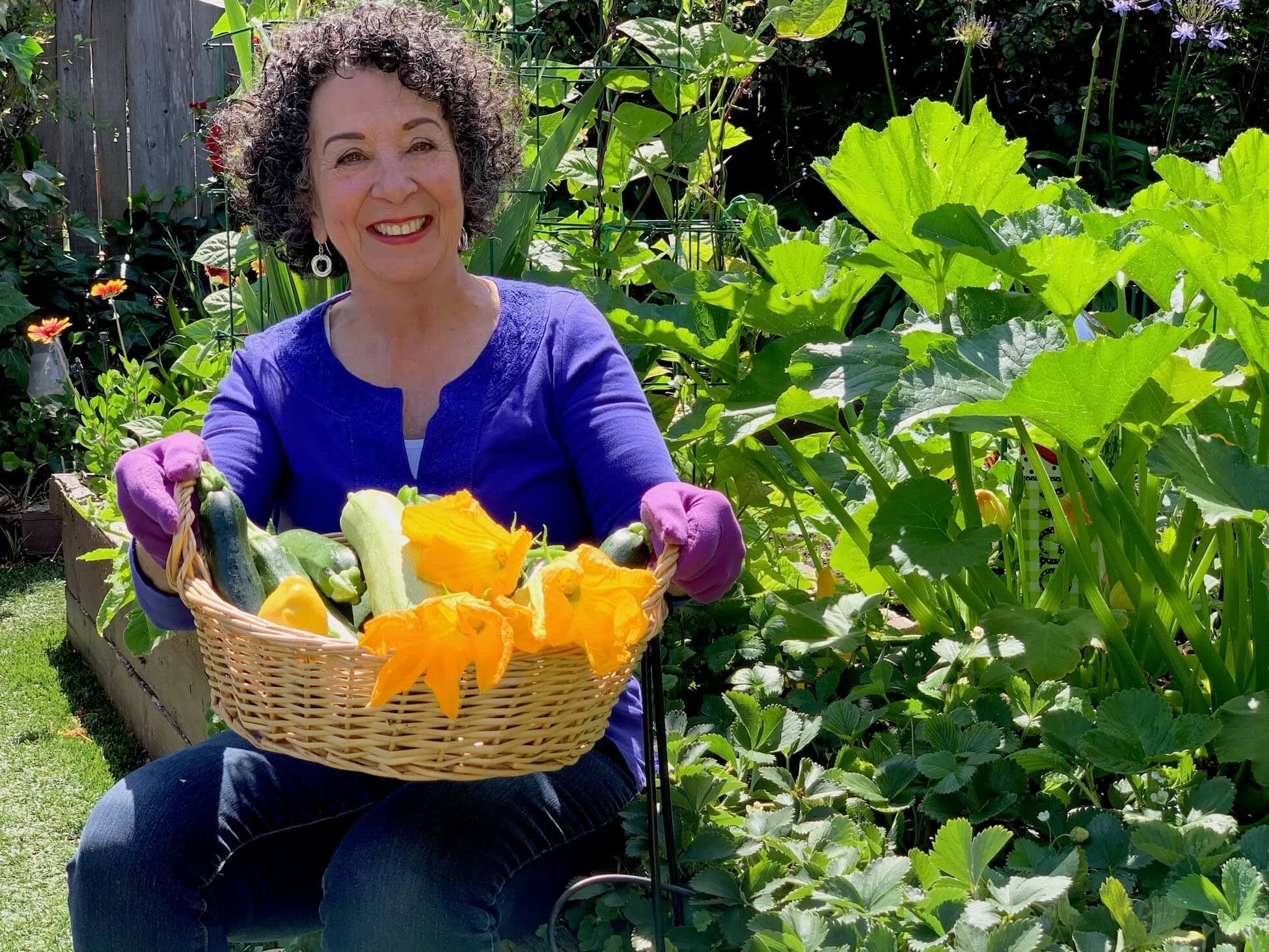 Author and gardener Toni Gattone shows off a basket of vegetables