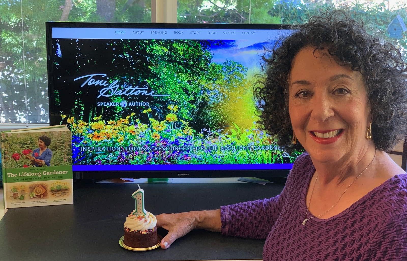 Toni Gattone sit in front of her Award Winning website on a desktop computer