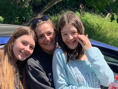 Our daughter Erin and our granddaughters Maddie and Caitlyn smile for a photo during their social distancing visit with us.