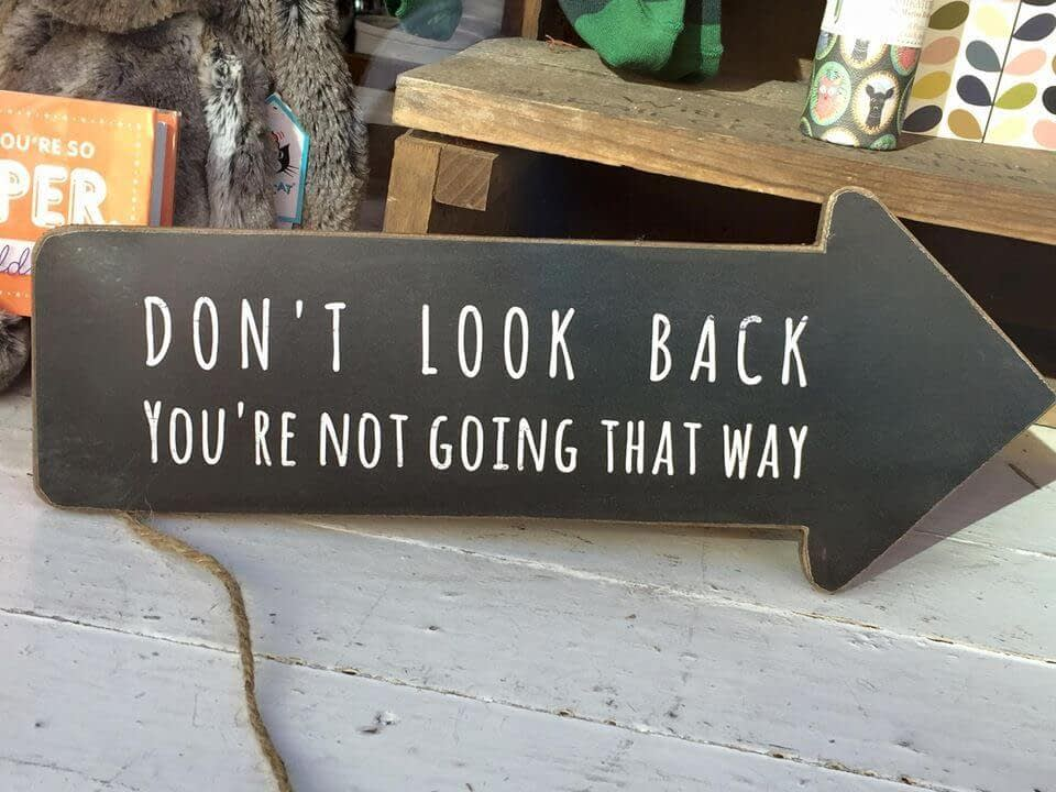 Don't look back, you're not going that way sign